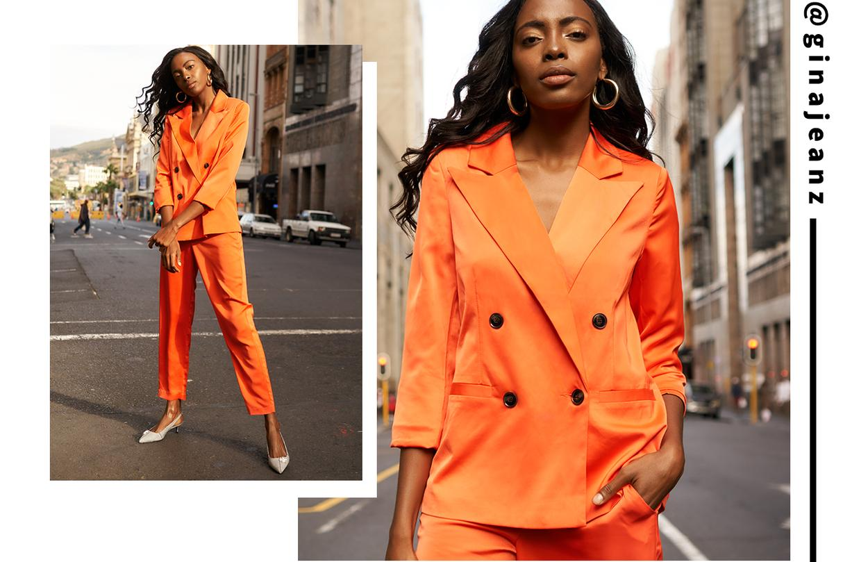 Gina Mwoombola - the bright suit