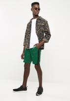 Superbalist - Tricot side stripe short - green & black
