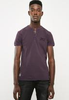 S.P.C.C. - Over dyed pique golfer with mandarin collar - purple