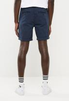 S.P.C.C. - Chino shorts with turn up hem - navy