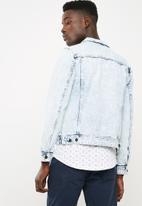 S.P.C.C. - Classic heavily bleached denim trucker jacket - blue