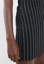 Superbalist - Mini bodycon with zip detail - black & white