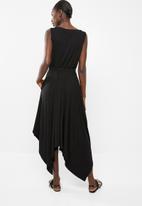 edit - Sleeveless dress with dipped hem - black