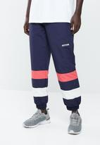 Asics Tiger - CB windbreaker pants - navy