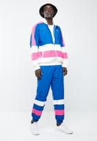 Asics Tiger - CB windbreaker pants - blue