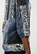 Revenge - Peasant blouse with contrast print - blue