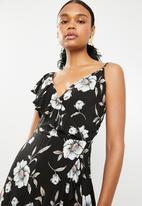 G Couture - Mock wrap with 1 shoulder frill - black