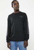 New Balance  - Athletic long sleeve tee - black