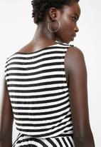 edit - Striped sleeveless dress with dipped hem - black & white