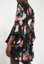 Revenge - Flare sleeve floral v-neck dress - black
