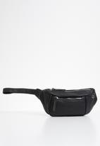 UNSEEN - Sidewinder waist bag - black