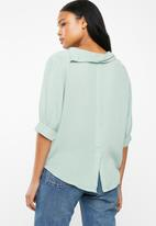 G Couture - Draped collar top - green