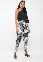 RUFF TUNG - Leaf print harem trouser - multi