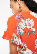 STYLE REPUBLIC - Tie front floral jumpsuit - orange