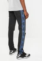 Levi's® - Ball stack stripe two pointer destruction jeans - black & blue