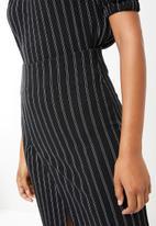 Superbalist - Spliced knit midi skirt - black & white