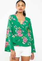 Superbalist - Bell sleeve wrap blouse - green floral