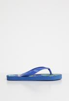 POP CANDY - Printed flip flops - blue