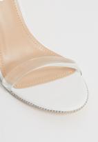Miss Black - Rowan ankle strap heels - white