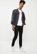 Diesel  - Sleenker slim fit concealed button down front fly jeans - black