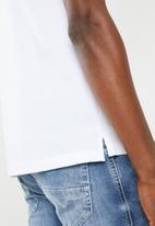 Diesel  - T-Randy broken short sleeve polo - white