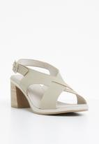 Phelan - Slingback leather heels - neutral