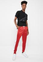 Superbalist - Slim side stripe tricot pant - red and white