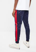 Superbalist - Slim side stripe tricot pant - navy and red