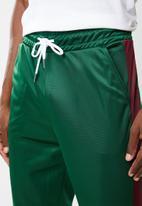 Superbalist - Slim side stripe tricot pant - green and maroon