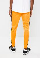 Superbalist - Slim side stripe tricot pant - orange and black