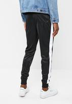 Superbalist - Slim side stripe tricot pant - black and white