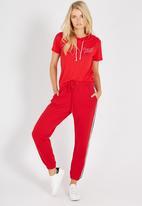 Supré  - Basic side stripe track pants - red