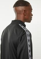 Umbro - Umbro retro taped tricot jacket - black