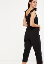 c7077eb08869 Woven flo tapered jumpsuit - black Cotton On Jumpsuits   Playsuits ...