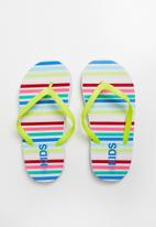 Cotton On - Printed flip flop - Yellow, Blue & Red
