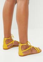 8ec88e40c462 Asymmetric strap flat gladiator sandal - yellow ALDO Sandals   Flip ...