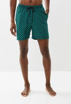 Superbalist - Printed elasticated swim shorts - black & green
