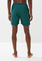 Superbalist - Printed elasticated swim shorts - black & green