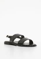 Truffle - Studded ankle strap flat sandals - black
