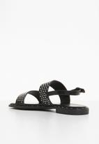 Truffle - Studded ankle strap flat sandals - black