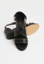 Truffle - Studded crossover low heel sandals - black