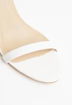Truffle - Barely there low heel sandals - white