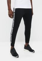 Asics Tiger - LT Jersey pants performance - black