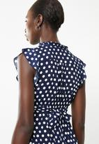 Revenge - Frilly polka dot dress - navy & white