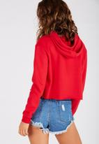 Supré  - Raw cut graphic hoodie - red
