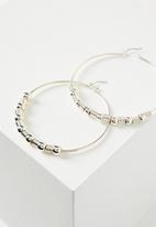 Rubi - Beaded hoop earrings - silver
