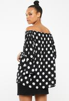 Revenge - Off shoulder polka dot top - black