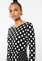 Revenge - Long sleeve all over polka dot dress - black