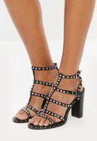 Truffle - Stud detail ankle strap block heel sandals - black