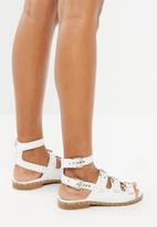 Truffle - Strappy studded sandal - white